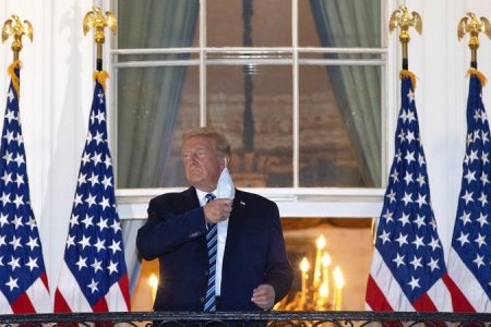 Trump enters Oval Office six days after White House return